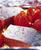 Salmon fillet with tomatoes on aluminium foil