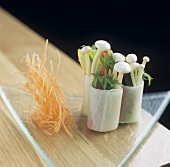Rice paper rolls filled with vegetables and enokitake