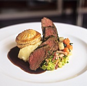 Beef filet with small pie, mashed potato and vegetables