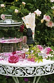 Romantic table with roses, rose punch and love poem
