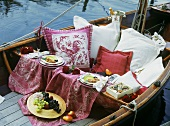 Romantic picnic for two on a boat