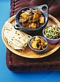 Beef and potato stew with roti (Surinam)
