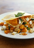 Lasagne with pumpkin, goat's cheese and hazelnuts