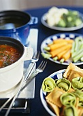 Fish fondue with pasta and vegetables