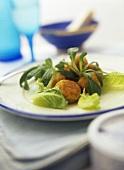 Deep-fried fish balls with salad