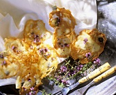 Home-made cheese crisps with thyme flowers