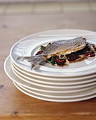 Sea bream with steamed rocket and pickled tomatoes