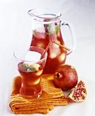 Still life with pomegranate juice and pomegranate