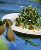 Rocket salad on artichoke hearts