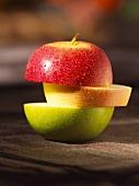 An apple sliced in three
