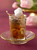 Tea with sugar cubes in Middle Eastern tea glass