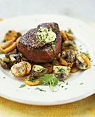 Beef steak with carrots and mushrooms
