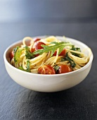Wholemeal spaghetti with cherry tomatoes and rocket