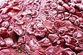 Frozen pomegranate (close-up)