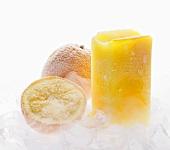 Frozen orange juice, oranges and ice cubes