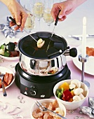Fondue with shrimps, vegetables and meat
