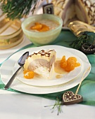 Ice cream bombe with mandarin oranges and yoghurt sauce