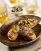 Variazione di crostini (Toasted bread with various toppings)