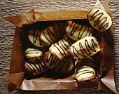 Orange tuiles with chocolate icing