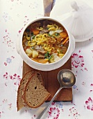 Hearty soup with stewing meat, potatoes, noodles & vegetables