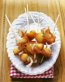 Apple and bacon on cocktail sticks
