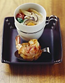 Asian coconut cream soup with bacon-wrapped prawn on toast