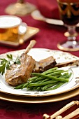 Grilled lamb cutlets with mustard sauce and green beans