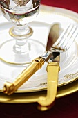 Festive place-setting with gold cutlery