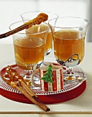 Apple punch with caramel cinnamon sticks