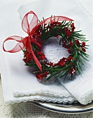 Spruce wreath with stars and artificial berries