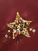 Christmas biscuits and sweets arranged in a star shape