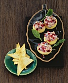 Red herring salad in apples with toast triangles