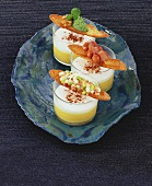 Potato soup with milk foam and toast with three toppings