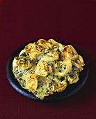 Baked tortellini with spinach and Gorgonzola sauce