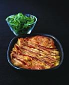 White bean bake with pancetta, rocket salad behind