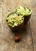 Raw vegetable salad with Parmesan and pecan oil