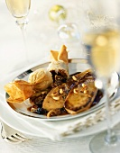 Fried goose liver and dried fruit in filo pastry