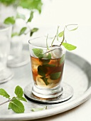 Mint tea with ice cubes