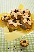 Orange nut muffins with orange cream & chocolate sprinkles