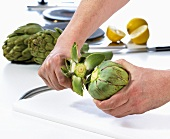 Removing the stalk from an artichoke