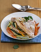 Salmon trout fillet with vegetables in saffron Prosecco sauce