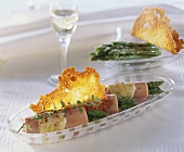 Ham and asparagus rolls with Parmesan crisps