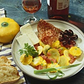 Plate of appetisers: patty pan squash, sheep's cheese, salami