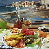 Plate of Greek appetisers in front of landscape