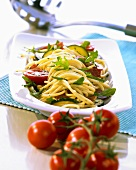 Vermicelli salad with salami, rocket, courgettes & tomatoes