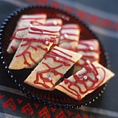 Christmas biscuits with red icing and silver dragées