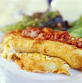 Pancake roll with sweetcorn filling and tomato sauce