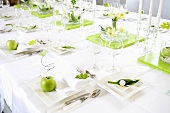 Table laid for special occasion (in green and white)