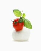 Tomato and mozzarella on cocktail stick with basil