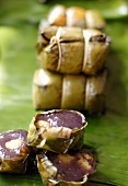 Sticky rice with spice paste steamed in banana leaves (Thailand)
